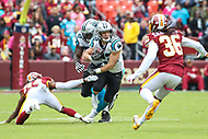 Landover, MD - October 14, 2018: Carolina Panthers running back Christian McCaffrey (22) avoids a tackle during the  game between Carolina Panthers and Washington Redskins at FedEx Field in Landover, MD.   (Photo by Elliott Brown/Media Images International)