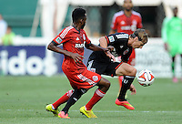 Washington D.C. - July 30, 2014: Chris Rolfe (18) of D.C. United  goes against Warren Creavalle (3) of Toronto FC.  D.C. United defeated the Toronto FC 3-1 during a Major League Soccer match for the 2014 season at RFK Stadium.