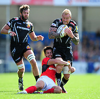 Damian Welch of Exeter Chiefs is tackled by Sean Maitland of Saracens. Aviva Premiership match, between Exeter Chiefs and Saracens on September 11, 2016 at Sandy Park in Exeter, England. Photo by: Patrick Khachfe / JMP