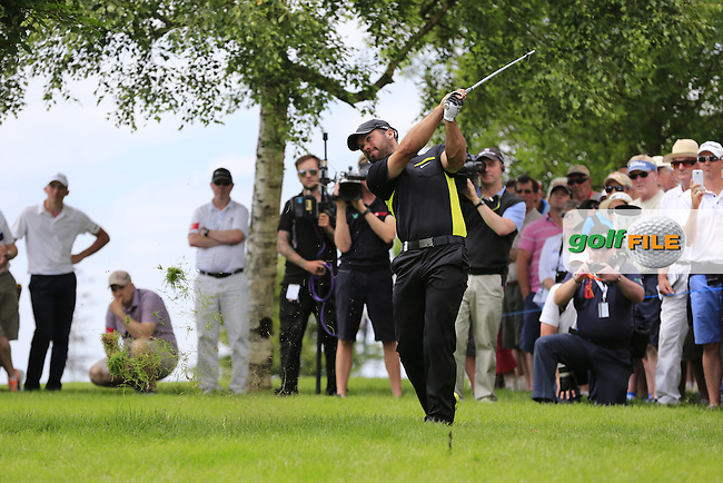 Paul Casey (ENG) plays his 2nd shot from the rough on the 9th hole during Friday's Round 2 of the 2014 Irish Open held at Fota Island Resort, Cork, Ireland. 20th June 2014.<br /> Picture: Eoin Clarke www.golffile.ie