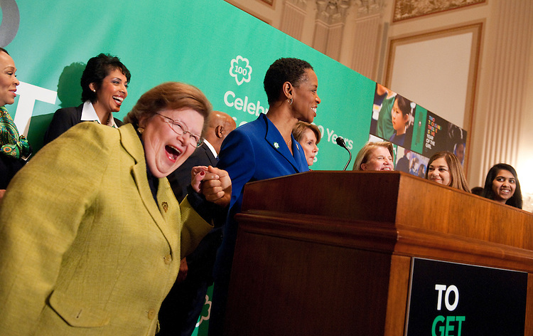 UNITED STATES - FEBRUARY 01:  Sen. Barbara Mikulski, D-Md., left, shares a laugh with Rep. Donna Edwards, D-Md., during a celebration of the Girl Scouts' 100th birthday in Cannon Caucus Room.  The event featured addresses by House Minority Leader Nancy Pelosi, D-Calif., HHS Secretary Kathleen Sebelius and other Congressional leaders.  (Photo By Tom Williams/CQ Roll Call)
