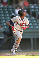 Shortstop Marcos Almonte (4) of the Rome Braves runs out a batted ball in Game 1 of a doubleheader against the Greenville Drive on Friday, August 3, 2018, at Fluor Field at the West End in Greenville, South Carolina. Rome won, 7-6. (Tom Priddy/Four Seam Images)