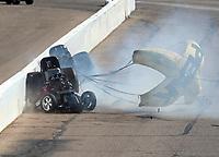 Feb 25, 2018; Chandler, AZ, USA; NHRA funny car driver Jonnie Lindberg (front) crashes with John Force during the Arizona Nationals at Wild Horse Pass Motorsports Park. Mandatory Credit: Mark J. Rebilas-USA TODAY Sports