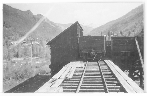 South-end view of the RGS Rico coaling trestle with a gondola spotted at the top as seen from the track center.<br /> RGS  Rico, CO