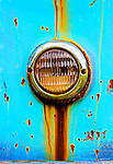 Headlight on an rusted turquoise Dodge pickup truck. Kodiak Island, Alaska