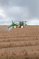 Spraying pre emergence residual herbicide onto potatoes - Lincolnshire, April