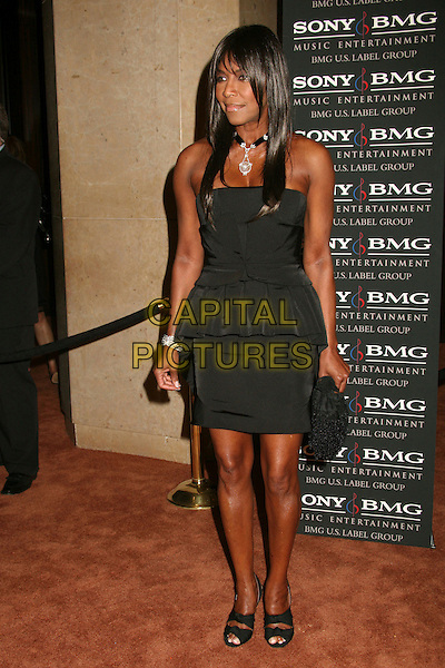 NATALIE COLE.Clive Davis 2007 Pre-Grammy Awards Party at the Beverly Hilton Hotel, Beverly Hills, USA..February 10th, 2007.full length black dress .CAP/ADM/BP.©Byron Purvis/AdMedia/Capital Pictures