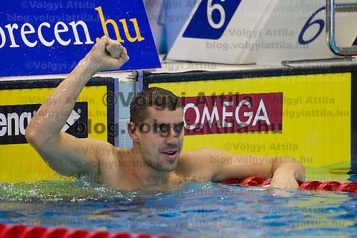 Damir Dugonjic of Slovenia celebrates his victory in the Men's 50m Brackstroke final of the 31th European Swimming Championships in Debrecen, Hungary on May 26, 2012. ATTILA VOLGYI