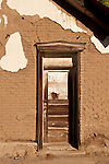Door in wall of old adobe building, Austin, Nev.