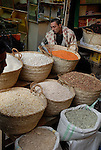 Local man selling cereals in the Sharia Souk in Luxor.The town of Luxor occupies the eastern part of a great city of antiquity which the ancient Egytians called Waset and the Greeks named Thebes.