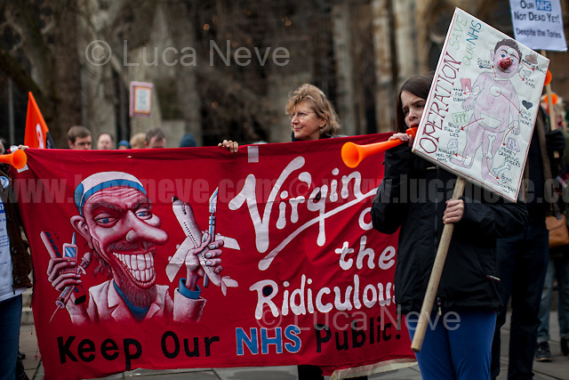 London, 28/01/2017. Today, activists, doctors, nurses and members of the public gathered outside the Houses of Parliament to march to the Department of Health in Richmond House. The demonstration, led by Hands Off Our NHS, was called to protest against the National Health Service (NHS) crisis which recently led the Red Cross to declare a humanitarian crisis in the British NHS and were forced to intervene. From the organisers Facebook event page: &lt;&lt;[&hellip;] With the imminent consultation around the government's &quot;Sustainability and Transformation Plans (STPs)&quot; NHS campaigning groups are joining forces with three main aims: 1. to raise public awareness that this is a package of &pound;22bn of underfunding to healthcare services; 2. to put pressure on local councils, our MPs, NHS England and Jeremy Hunt to restore our NHS; 3. to hold a national demonstration and rally on Saturday 28th January 2017. We have chosen this date because the delivery and implementation of these plans will take place from January to March 2017 [&hellip;]&gt;&gt;.<br />