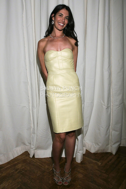"""Adrienne Zernich poses backstage after her Adrienne Zernich Spring 2011 """"Romantic Garden Party"""" collection, at the National Arts Club on September 14, 2010."""