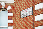 Close up of residential building and street sign in Observatory Gardens, Kensington, London