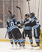 Connor Leen (Maine - 29), Ben Hutton (Maine - 10), Brice O'Connor (Maine - 16), Devin Shore (Maine - 94) - The University of Maine Black Bears defeated the Boston University Terriers 7-3 (2EN) on Saturday, January 11, 2014, at Fenway Park in Boston, Massachusetts.