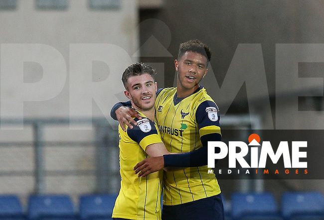 Tyler Roberts (right) of Oxford United celebrates his goal with Dan Crowley of Oxford United during the The Checkatrade Trophy match between Oxford United and Exeter City at the Kassam Stadium, Oxford, England on 30 August 2016. Photo by Andy Rowland / PRiME Media Images.