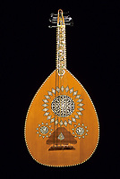 Syrian Oud or 'Ud, made in Damascus, with ivory and mother-of-pearl decoration.  Unlike the European lute, the oud has no frets on the neck to aid the placement of fingers.
