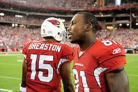Sept. 27, 2009; Glendale, AZ, USA; Arizona Cardinals wide receiver (81) Anquan Boldin with teammate Steve Breaston against the Indianapolis Colts at University of Phoenix Stadium. Indianapolis defeated Arizona 31-10. Mandatory Credit: Mark J. Rebilas-