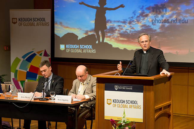 "Apr. 6, 2016; Notre Dame President Rev. John I. Jenkins, C.S.C. speaks during the panel discussion: ""Universities: Responding to an Urgent Call,"" part of the Keough School of Global Affairs conference ""For the Planet and the Poor."" (Photo by Matt Cashore/University of Notre Dame)"