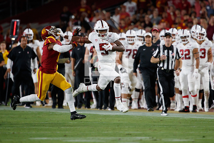 LOS ANGELES, CA - SEPTEMBER 7: Connor Wedington #5 runs after making a catch and is pursued by USC Trojans Palaie Gaoteote IV #1 during a game between USC and Stanford Football at Los Angeles Memorial Coliseum on September 7, 2019 in Los Angeles, California.