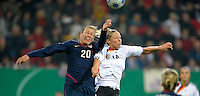 Abby Wambach (20) goes up for the header over Kim Mulig (14). US Women's National Team defeated Germany 1-0 at Impuls Arena in Augsburg, Germany on October 29, 2009.