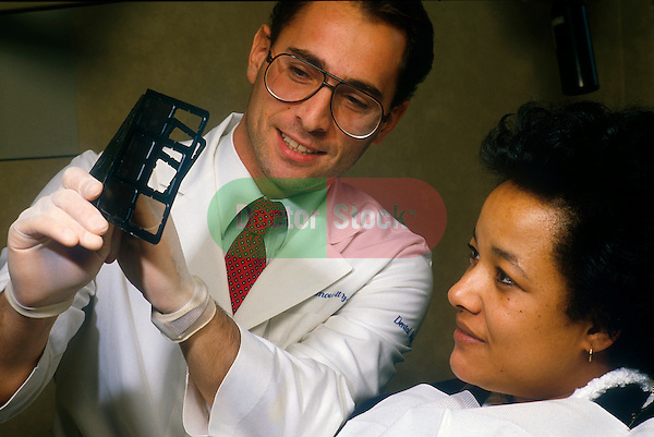 Dentist reviewing x-ray with woman patient