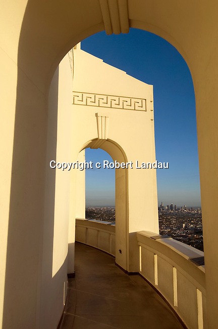 Art Deco arched walkway around the Griffith Park Observatory with views of  Downtown Los Angeles