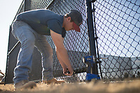 NWA Democrat-Gazette/CHARLIE KAIJO Brandon Combs of Carnahan-White clips zipties used to secure windscreens, Monday, February 4, 2019 at the new tennis courts at the Bentonville Community Center in Bentonville.<br />