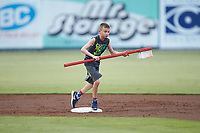 A young fan cleans second base with a giant toothbrush between innings of the South Atlantic League game between the Hagerstown Suns and the Kannapolis Intimidators at Kannapolis Intimidators Stadium on August 27, 2019 in Kannapolis, North Carolina. The Intimidators defeated the Suns 5-4. (Brian Westerholt/Four Seam Images)