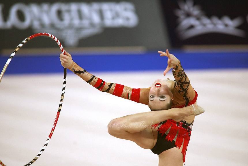 September 21, 2007; Patras, Greece;  Elizabeth Paisieva of Bulgaria turns pirouette (in ring position) with hoop during All-Around final at 2007 World Championships Patras.  Betty helped Bulgaria to receive the 2nd of 2 positions for the individual All-Around at Beijing 2008 Olympics.  Photo by Tom Theobald. .