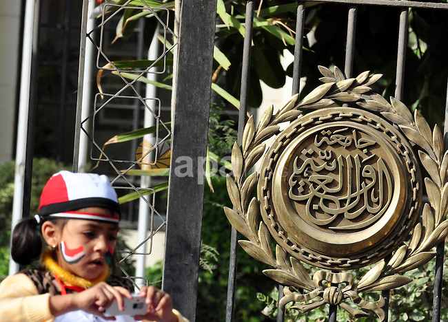 Protesters take part in a protest against Libyan Leader Moammar Gadhafi  in front of the Arab league in Cairo, Egypt, Feb. 22, 2011. Protesters gathered at the protest against Gadhafi's crackdown on peaceful protesters in Libya. Photo by Ahmed Asad