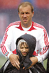 15 April 2007: New York's Clint Mathis lent his warm-up jacket to the youngster who accompanied him onto the field for pregame activities. The New York Red Bulls defeated FC Dallas 3-0 at Giants Stadium in East Rutherford, New Jersey in an MLS Regular Season game.