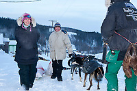 Volunteer checkers Jamie Kohn (L) and Sue Morgan haul Sven Haltman's food to him at the village checkpoint of Ruby during the 2010 Iditarod