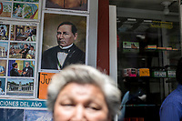 June 6, 2018: A pedestrian passes by in front of a picture of Benito Juarez at streets of Teziutlan municipality during the campaign rally of Andres Manuel Lopez Obrador, an opposition candidate of MORENA party running for presidency (not-pictured) in Mexico. National elections will be hold on July 1.