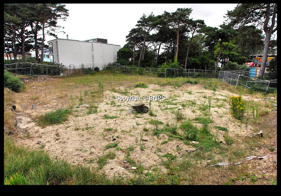 BNPS.co.uk (01202 558833)<br /> Pic: PhilYeomans/BNPS<br /> <br /> The waste land that stood before the homes were built. <br /> <br /> Two luxury homes squeezed onto a plot meant for one have gone up for sale for 13 million pounds - three times the value of the former property.<br /> <br /> A three bedroom house occupied the site on Sandbanks in Poole Harbour until it was bought for 4.25 million pounds and then promptly demolished.<br /> <br /> A development company decided to eke out every square inch of the plot by splitting it in two and building a pair of four storey beachfront houses worth 6.5 million pounds each.