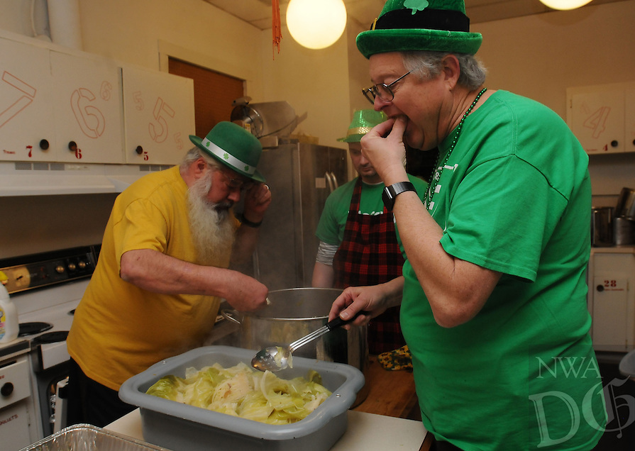 NWA Democrat-Gazette/FLIP PUTTHOFF <br /> ST. PATS AT ST. ANDREWS<br /> Mike Kisch (from left) and James Crews fix a traditional St. Patrick's Day meal at St. Andrew's Episcopal Church in Rogers on Saturday March 12, 2016 while James LeFevre makes sure the cabbage is done. The church men's group cooks the main course of corned beef and cabbage and women of the church bring desserts. The St. Patrick's Day meal has been a tradition at the church for years, the cooks said.