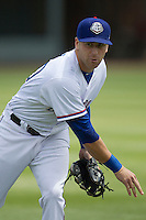 Round Rock Express third baseman Mike Olt #20 warms up before the game against the New Orleans Zephyrs in the Pacific Coast League baseball game on April 21, 2013 at the Dell Diamond in Round Rock, Texas. Round Rock defeated New Orleans 7-1. (Andrew Woolley/Four Seam Images).