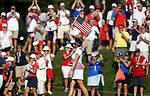DES MOINES, IA - AUGUST 19: USA's Gerina Piller waves a flag following Saturday's matches against Europe at the 2017 Solheim Cup in Des Moines, IA. USA leads 10 1/2 to 5 1/2 heading into Sunday's Singles matches. (Photo by Dave Eggen/Inertia)