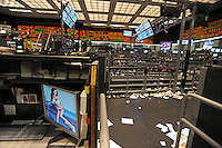 A computer desk top with a girl in a bikini is seen beside the empty trading floor after the closing bell at the CME Group in Chicago, Illinois on October 10, 2008.