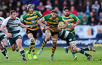 Tom Wood of Northampton Saints is tackled in possession. Aviva Premiership match, between Northampton Saints and Leicester Tigers on April 16, 2016 at Franklin's Gardens in Northampton, England. Photo by: Patrick Khachfe / JMP