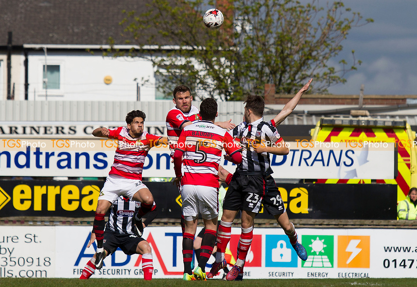 Dan Jones of Grimsby T  and Mathieu Baudry of Doncaster Roversduring Grimsby Town vs Doncaster Rovers, Sky Bet EFL League 2 Football at Blundell Park on 1st April 2017