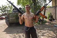 Russia-backed rebels take positions on the outskirts of Donetsk, eastern Ukraine, Thursday, April 26, 2015
