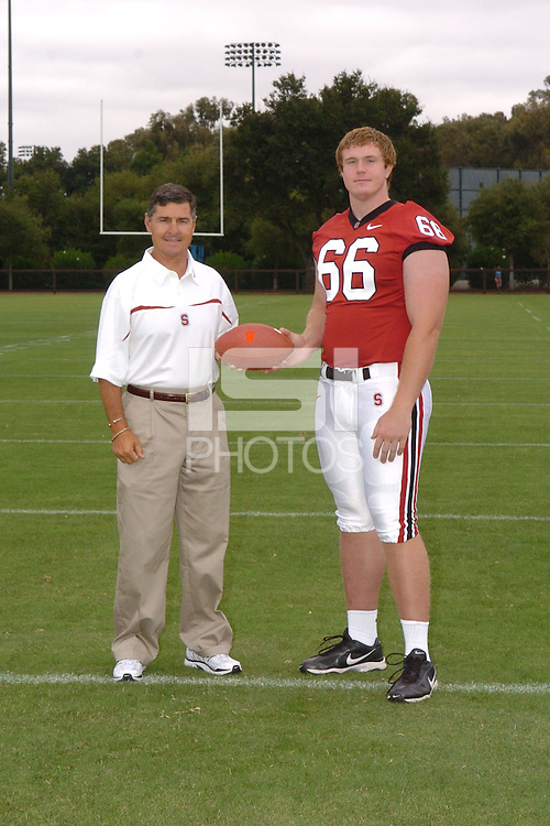 7 August 2006: Stanford Cardinal head coach Walt Harris and Michael Macellari during Stanford Football's Team Photo Day at Stanford Football's Practice Field in Stanford, CA.