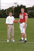 7 August 2006: Stanford Cardinal head coach Walt Harris and Michael Macellari during Stanford Football's Team Photo Day at Stanford Football's Practice Field in Stanford, CA.
