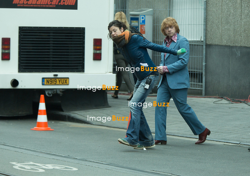 EXCLUSIVE - Rupert Grint was seen leaving his hotel and on his way to the movie set ' Moonwalkers ', in Brussels, Belgium.<br /> On the set, Rupert Grint and English co-star Robert Sheehan.were seen wearing outfits from the 60's.<br /> Belgium, Brussels, May 30, 2014.