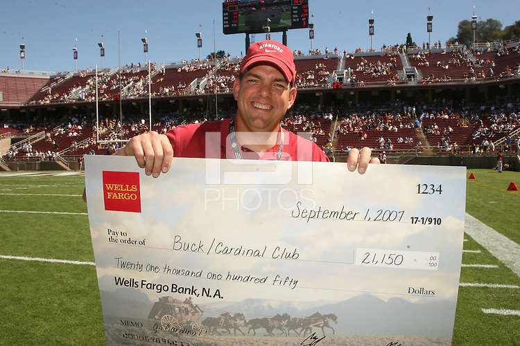 1 September 2007: Kevin Richardson is presented a check by a sponsor representative from Wells Fargo during Stanford's 45-17 loss to the UCLA Bruins at Stanford Stadium in Stanford, CA.