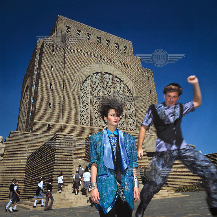 Fashion designers Shanie Boerstra and Jerome Argue pose in front of the Voortrekker Monument.