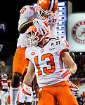 Clemson wide receiver Deon Cain (8) celebrates with Hunter Renfrow after Renfrew's 24 yard touchdown reception in the second half of the 2017 College Football Playoff National Championship in Tampa, Florida on January 9, 2017.  Clemson defeated Alabama 35-31. Photo by Mark Wallheiser/UPI