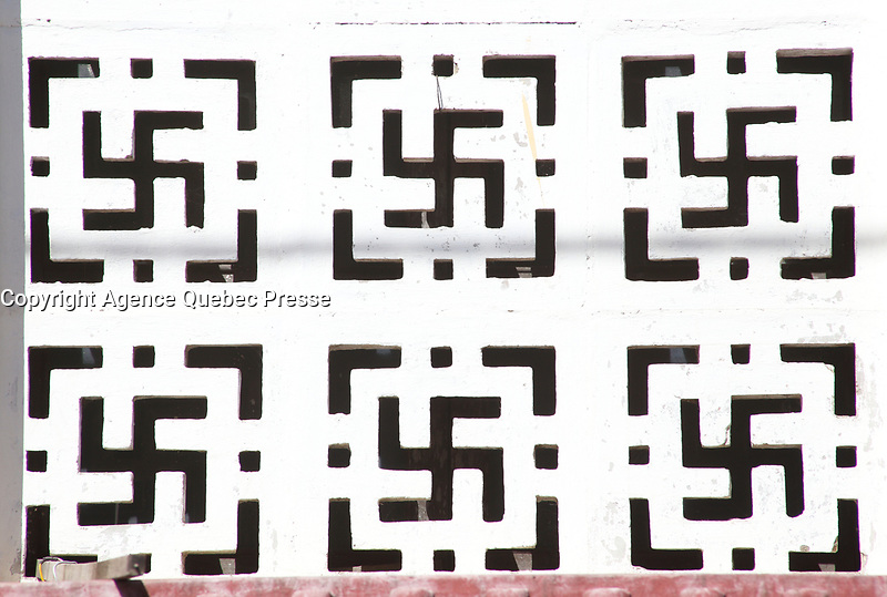 swastikas seen from outside a temple<br />  in <br />  Hoi An, January, 2017