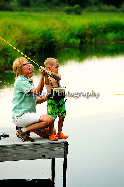 Kids learning to fish off a dock in a pond in Northeast PA