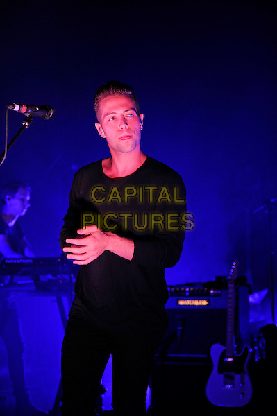 LONDON, ENGLAND - JULY 2: Thom Powers of 'The Naked and Famous' performs live at the Shepherd's Bush Empire on July 2, 2014 in London, England.<br /> CAP/MAR<br /> &copy; Martin Harris/Capital Pictures